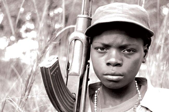 Ugandan-Child-Holding-a-Rifle-Uvureview.com_