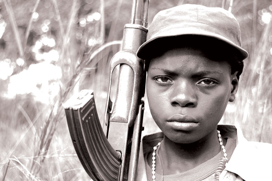 Ugandan-Child-Holding-a-Rifle-Uvureview.com_